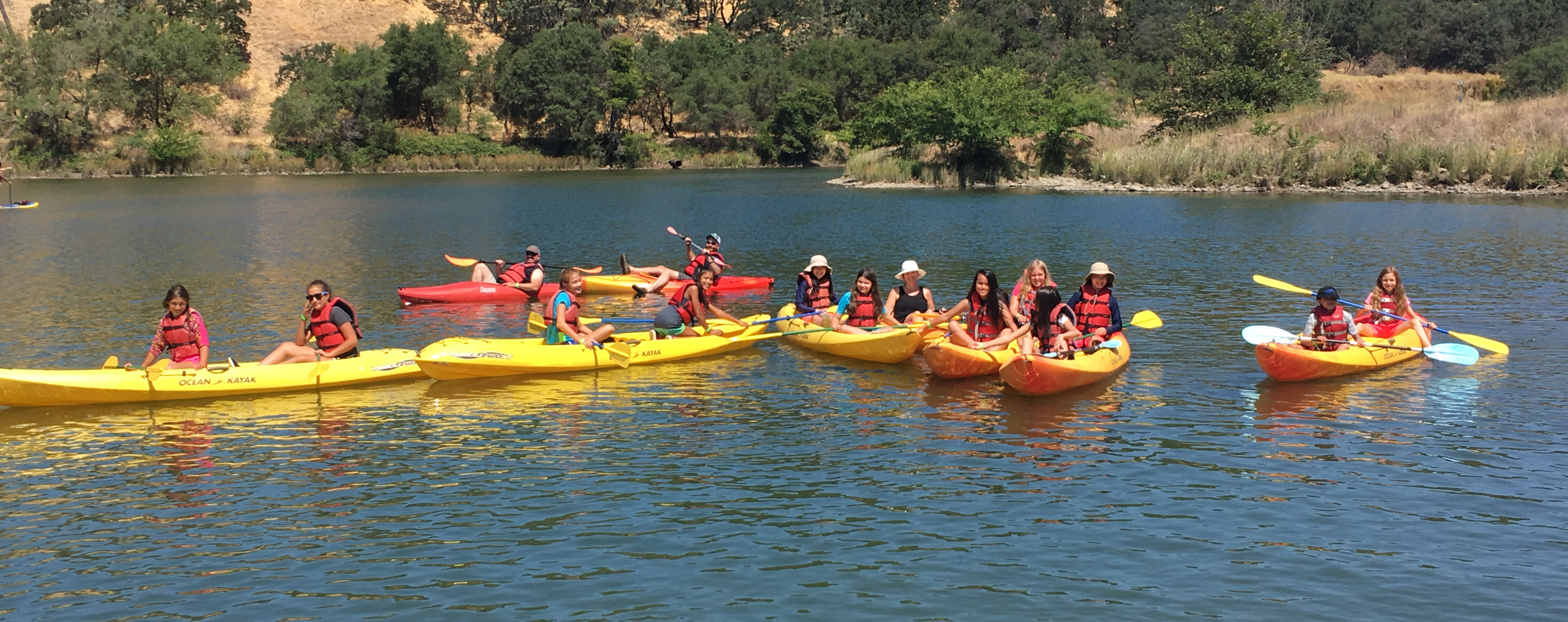 Campers kayaking on Lake Natoma