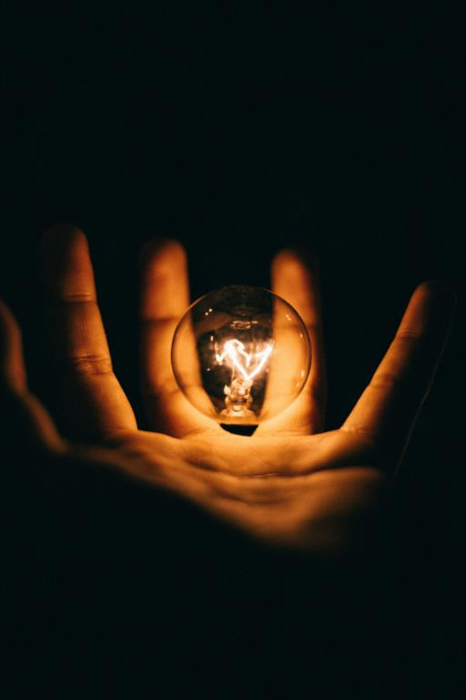 Photo of lightbulb in a hand by Rohan Makhecha on Unsplash
