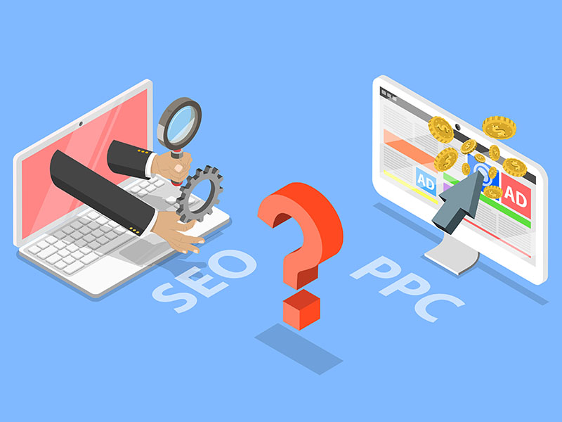 Photo of a laptop with SEO and computer with PPC